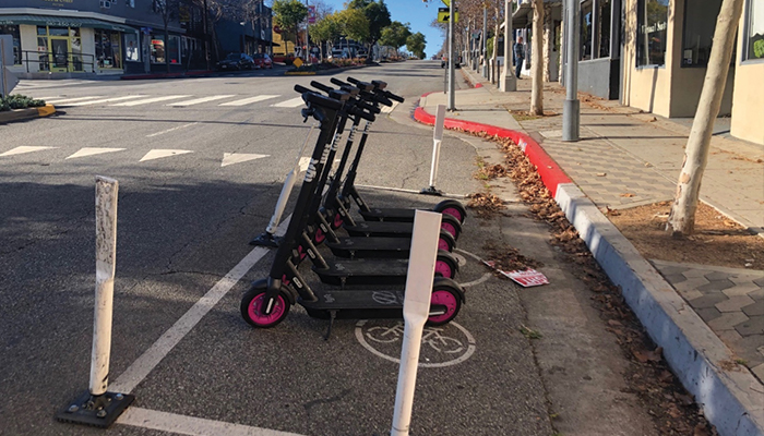 Electric scooters parked on street in designated spot